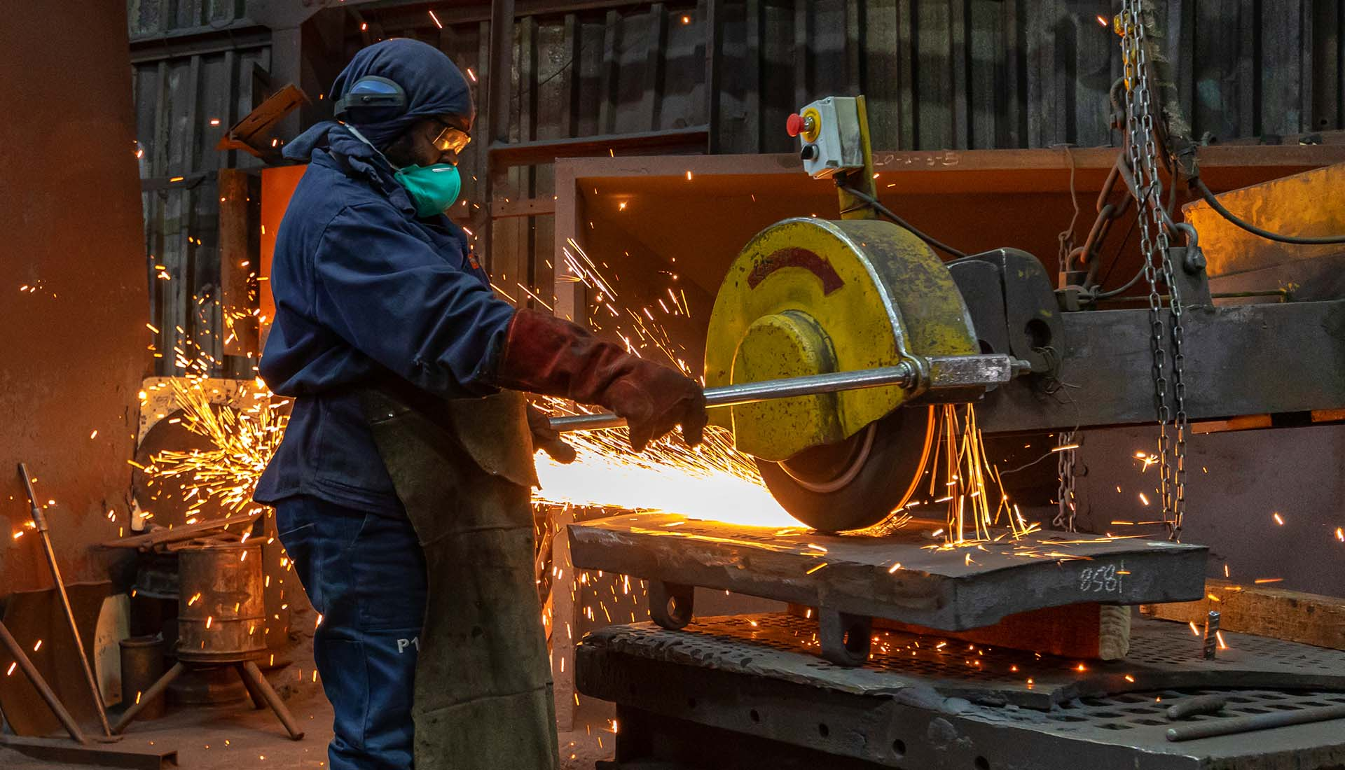 Industrial Photography, Man grinding steel in a foundry.