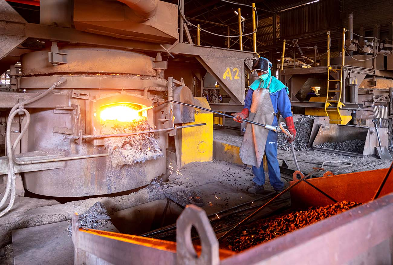 Industrial Photography, Man working in foundry. Prima Foundry
